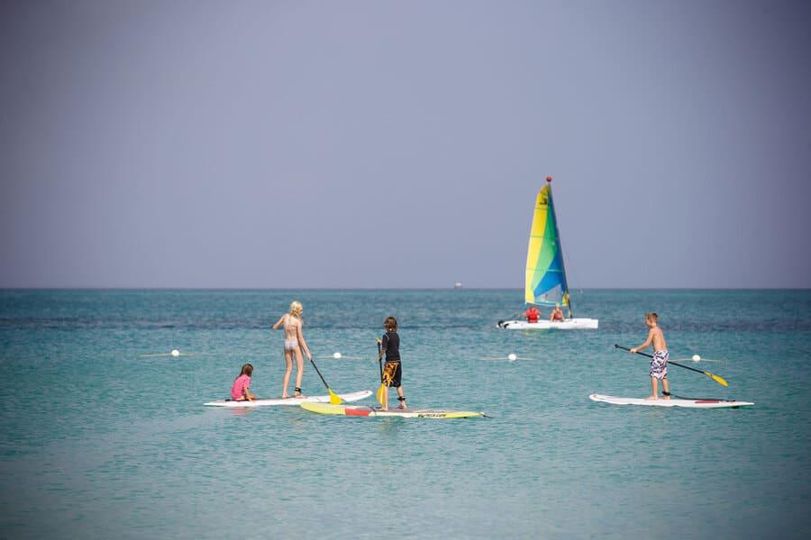 Kids enjoying beach activities at Ocean Club Resort - Photo by Ocean Club Resort