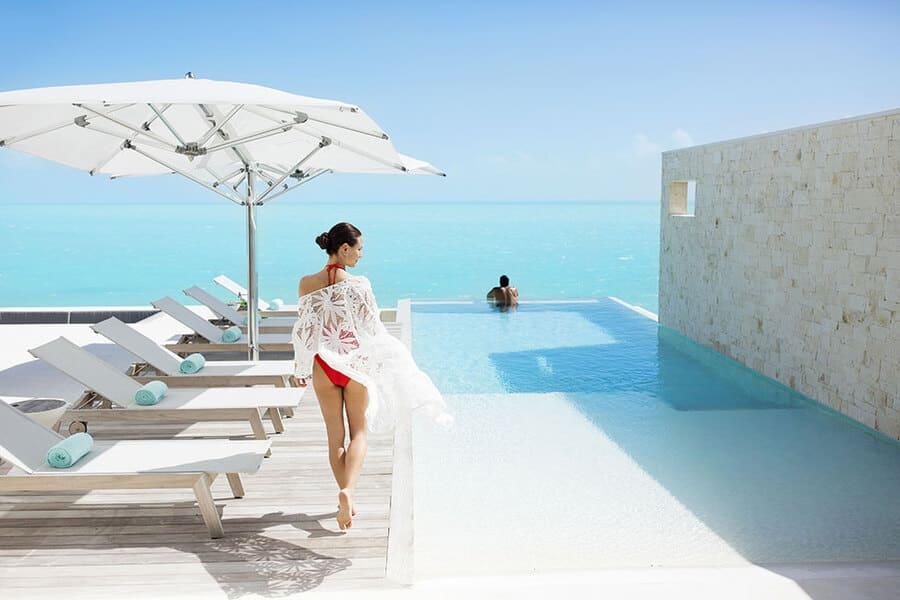 Couple at Infinity Pool - Photo credit Wymara Resort & Villas