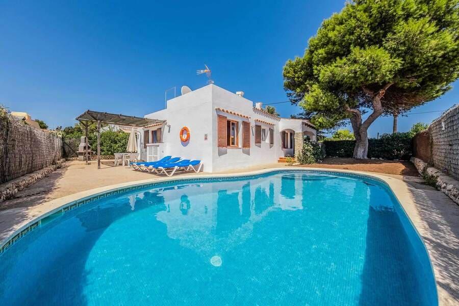 Pool area at Villa Iris Prima, Punta Prima, Menorca